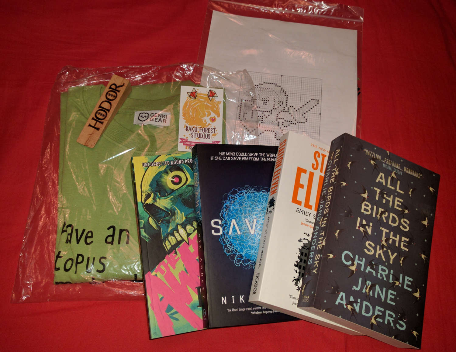 Picture of prizes (books, a t-shirt, and other bits
