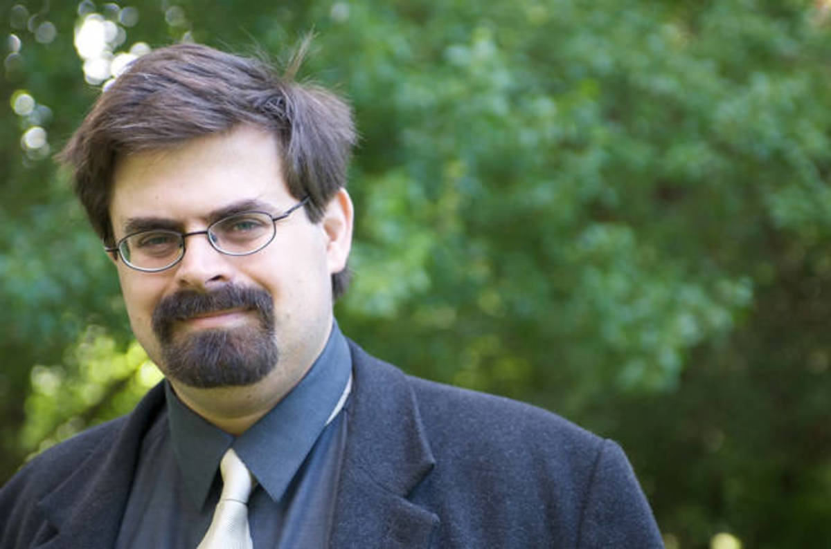 Adrian Tchaikovsky in a suit.