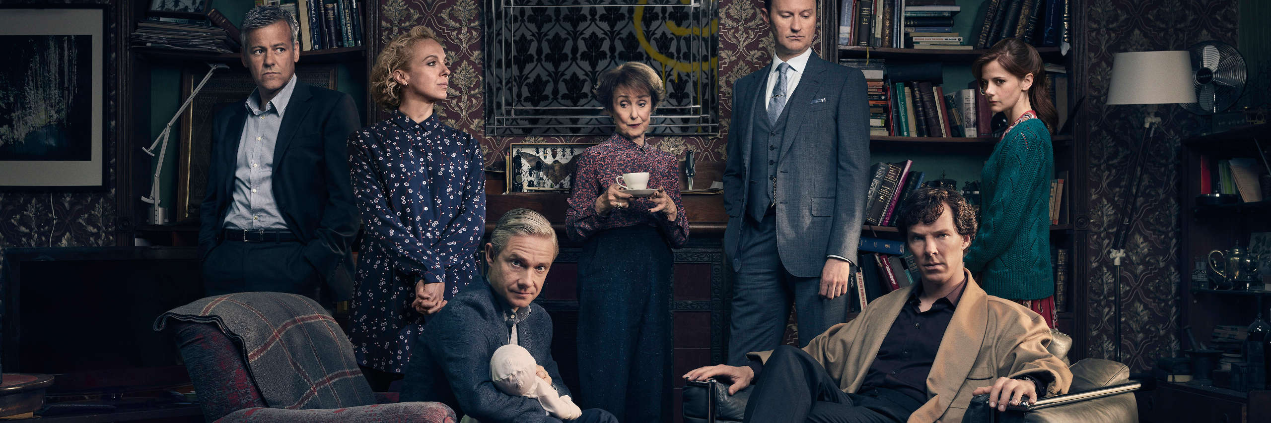 Cast of The Six Thachers, in front of Sherlock's fireplace